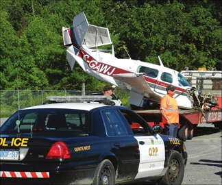 Downed aircraft makes a tricky load for towing company– Image 1