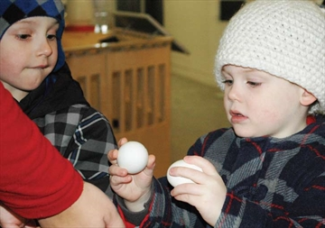 Evan Pick, from Orléans looks on as Liam Shaw takes a look at some eggs during the Barnard Bazaar exhibit at the Canadian Agricultural Museum on Nov. 30.