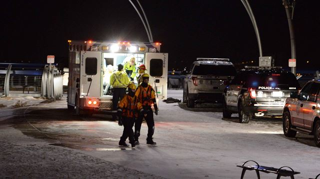 Woman rescued from frigid lake waters off Burlington pier