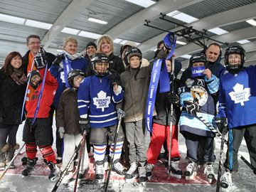 Politicians, parents, and kids cut the ribbon on Greenwood Park's new outdoor covered rink Saturday, Nov. 23.