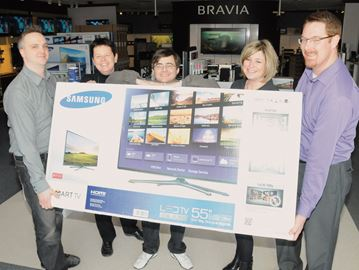 Reader Survey winner collects prize in Barrie