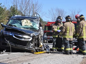 Burlington man in serious condition after head-on collision with school bus