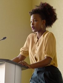 """Rita Ngarambe presents a poem """"I Remember"""" at a ceremony to mark the 24th anniversary of the Rwandan Genocide."""
