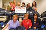 Backpack donations for kids 'about community spirit'