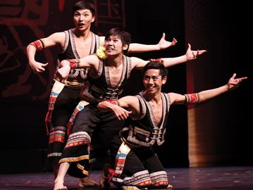 Luo Tian, Du Shangqu, and Ning Bowen, in no particular order, perform Young guys, four strings, and a lantana flower during the Chinese New Year Carnival 2014 performance at Centrepointe Theatre on Feb. 19.