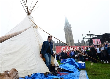 Prime Minister Justin Trudeau leaves a Teepee on Parliament Hill in Ottawa on Friday, June 30, 2017. Trudeau had a brief meeting this morning with indigenous activists who have set up a demonstration teepee on Parliament Hill ahead of Canada Day celebrations. THE CANADIAN PRESS/Sean Kilpatrick