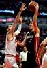 Butler, Wade lead Bulls to 105-100 win over Heat-Image3