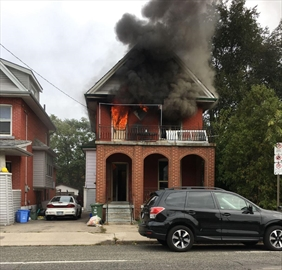Smoke and flames pour out of a home at 703 Wilon St. Thursday morning fire.