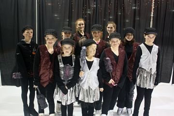 The chimney sweepers skated to Dick Van Dyke's Step in Time number.  Front row: Dana Tulloch, Sydney Martin, Renayla Campbell, Madison Saunders and Mackenzie Dorgelo. Back Row: Travis Fulford, Sarah Storrey, Bailey Campbell, Grace Woodhouse, Hannah Fulford and Courtney McKnight.
