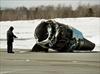 Officials finish examining plane crash site-Image1