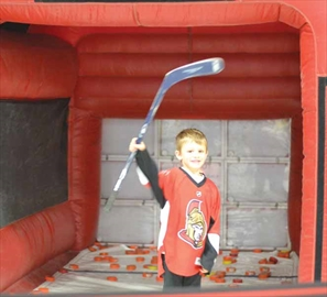 Owen Wantuck, of Orléans, 6, celebrates after playing a shooting accuracy game at Hockeyfest on Nov. 24 at the Ernst and Young Centre. The two-day event was held for the first time this year and featured games, vendors and speakers.
