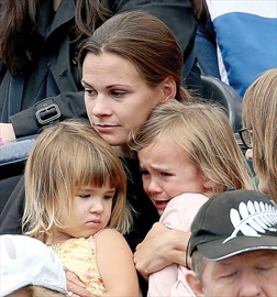 LONDON, ENGLAND -- Simon Whitfield's wife consoled their two daughters after he crashed his bike and withdrew from the triathlon race August 7 at the London 2012 Olympic Games. August 7, 2012