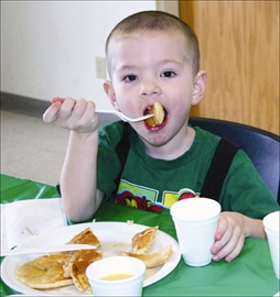 The biting cold could not keep people away from this year's March Meltdown, held in Beckwith Township on Saturday, March 1. Once again, the Beckwith Youth Committee hosted the event, which featured a day packed full of free, fun activities for everyone. Four-year-old Colton Neale of Carleton Place enjoys a pancake breakfast at Brunton Community Hall.