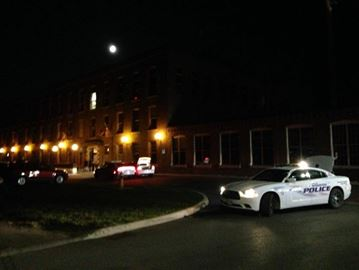 Police respond to incident at Woolen Mill building