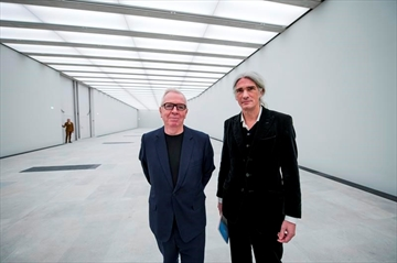 Architects David Chipperfield, left, and Alexander Schwarz pose in an exhibition hall of the the new James Simon Gallery in Berlin Thursday, Dec. 13, 2018. Berlin has completed a new addition to its Museum Island complex aimed at completing the ensemble of popular museums and making it more user-friendly. (Bernd von Jutrczenka/dpa via AP)