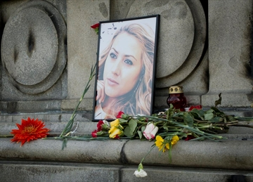 The photo of Viktoria Marinova, a television journalist who was raped and strangled on Saturday, is placed on the Liberty Monument in Ruse, Bulgaria, Wednesday, Oct. 10, 2018. German police have arrested a suspect in the rape and killing of Marinova, whose work highlighted corruption in the East European country.