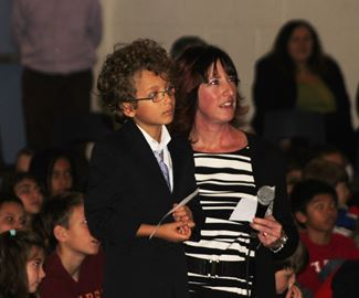 Grade 1 student Jake Skilnick with St. Marguerite teacher Alison Bogle asking Commander Hadfield a question via Skype.