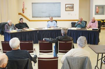 Magnetawan councillors discuss items on the agenda at the April 9 council meeting.