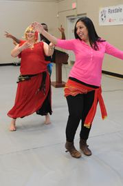 Rexdale Women's Centre held its International Women's Day event on Friday, with speakers, displays and entertainment. Here, Anuta Puthran tries her hand at belly dancing. (March 7, 2014)