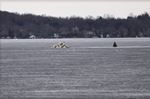 Ice huts sinking into Lake Simcoe