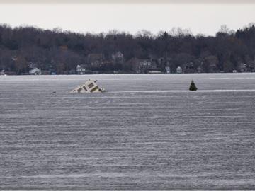 Ice huts sinking into Lake Simcoe