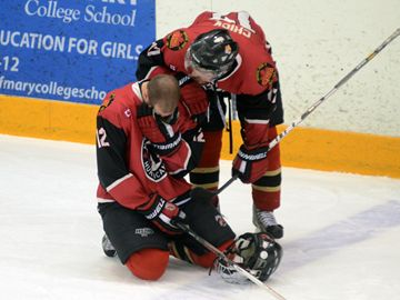 Newmarket Hurricanes forward Taylor Chick consoles teammate Elliott Burlon following game seven of their OJHL final series at the St. Michaels College School Arena, Sunday.