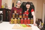 Nathalie Banger (Left) and Kat Evans with some of their canned goodies.