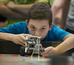 Paolo Ramelli, 11, a Grade 6 student from St. David Catholic Elementary School, lines up his robot at the third annual Hamilton Wentworth Catholic District School Board FIRST LEGO League qualifying event at Cardinal Newman Catholic Secondary School Saturday.