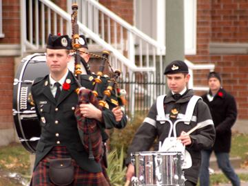 Bagpipers lead the parade to the Centrepointe cenotaph during the Remembrance Day ceremony on Nov. 11.