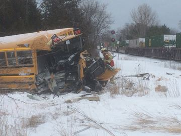 School bus struck by train