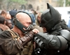 Tom Hardy as Bane and Christian Bale as Batman face off in The Dark Knight Rises.