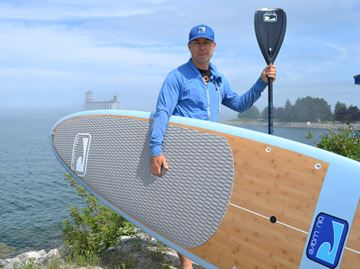 Surfer brings stand-up paddle board shop to Collingwood