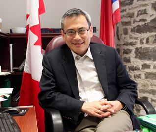 Ted Hsu in his office in Kingston.