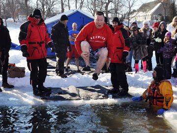 Georgina Fire Department firefighter Darren Peters does his best cannonball during the second annual YRP Polar Plunge Saturday.