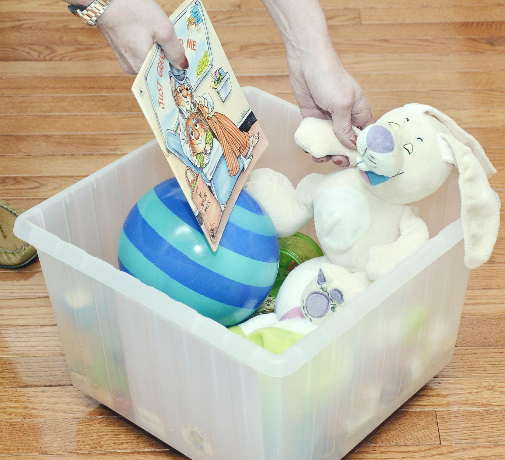 Put toys in plastic bins on wheels