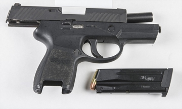 A SigSauer 9mm handgun Peel Regional Police say they seized after arresting an armed robbery suspect near a Mississauga strip club.