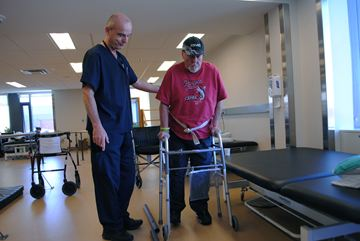 Hotel-Dieu Grace Healthcare physiotherapist Carlo Giovanatti helps patient Robert Graham during a rehabilitation session at the facility April 22.