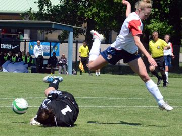 London Gryphons Lauren Winquist can't beat Laval Comets goaltender Genevieve Richard to the ball during Saturday's (May 25) W-League game at the North London Fields.