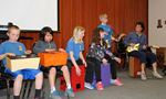 Bath Public School teacher Carol Baetz (far right) performs on a loog guitar with other students joining her on cajons and cajon bongos.