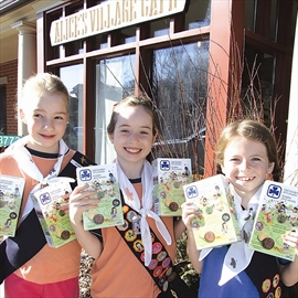 Selling cookies for the 1st Carp Guides and Brownies at Alice's Village Café in Carp for Girl Guide Day in Ontario Saturday are, front left, 2nd Carp Brownies Elizabeth Miller, Emma Croucher and Tegan Price.
