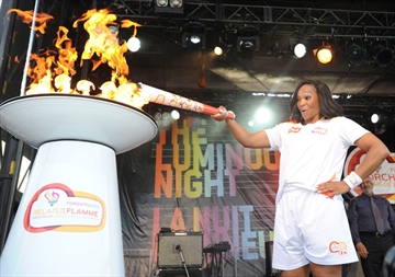 Torchbearer Moore proud to light Pan Am flame on Prince Edward Viaduct-image1