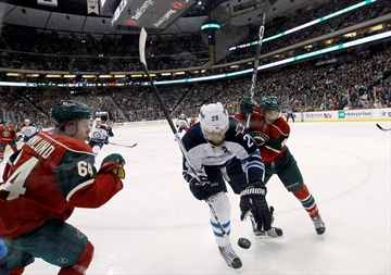 Hellebuyck hangs on to win debut, Jets beat Wild 3-1-Image1