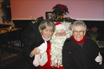 Before the parade held in his honour began Saturday night in Colborne, Santa stopped by the Sweet Passions Bakery &amp
