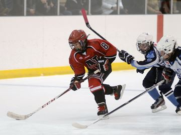 Newmarket Redmen player Andrew Ferris enters the North Bay Trappers zone during Minor Atom AA final play at the 63rd Annual Newmarket Atom Tournament, Sunday. North Bay won 3-2. (Nick Iwanyshyn/York Region Media Group)