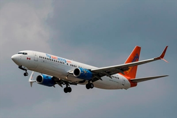 A Sunwing Boeing 737-800 passenger plane prepares to land at Pearson International Airport in Toronto on Wednesday, August 2, 2017. A national union representing thousands of flight attendants is using a recent court ruling to push the federal government to tighten airline passenger safety rules.A Federal Court of Appeal judge ruled last week that Transport Canada couldn't have reasonably concluded that passenger or crew safety wasn't compromised when it allowed Sunwing Airlines to increase the ratio of passengers to flight attendants on its aircraft. THE CANADIAN PRESS/Christopher Katsarov