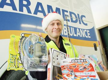 County paramedics collect toys at Orillia Santa parade