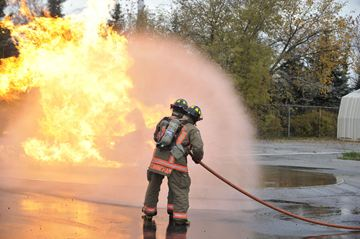 Toronto Firefighters demonstrate how to put out a car fire during the Take Our Kids to Work Day Wednesday, Nov. 6 at the Fire Academy.