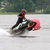 Snowmobile racers ride the waves on Midland's Little Lake