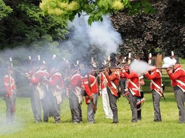 British troops return fire in defence of Fort York against the advancing American forces during the War of 1812 re-enactment of the Battle of York in 1813.