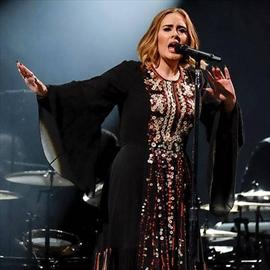 Adele's son swears-Image1